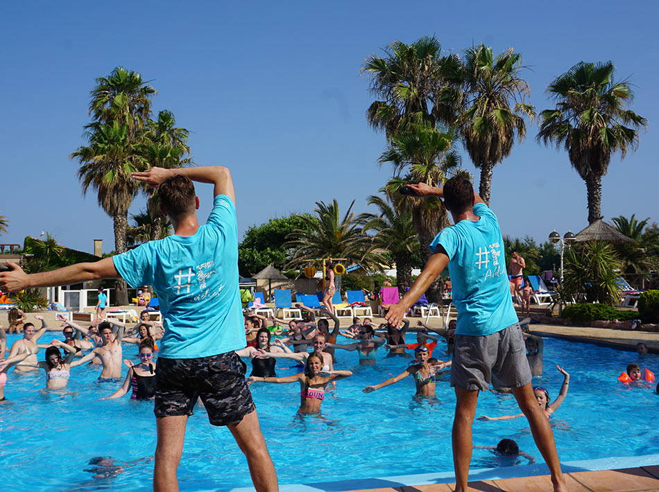 aquadance the dances of the village in the swimming pool of the camping club farret