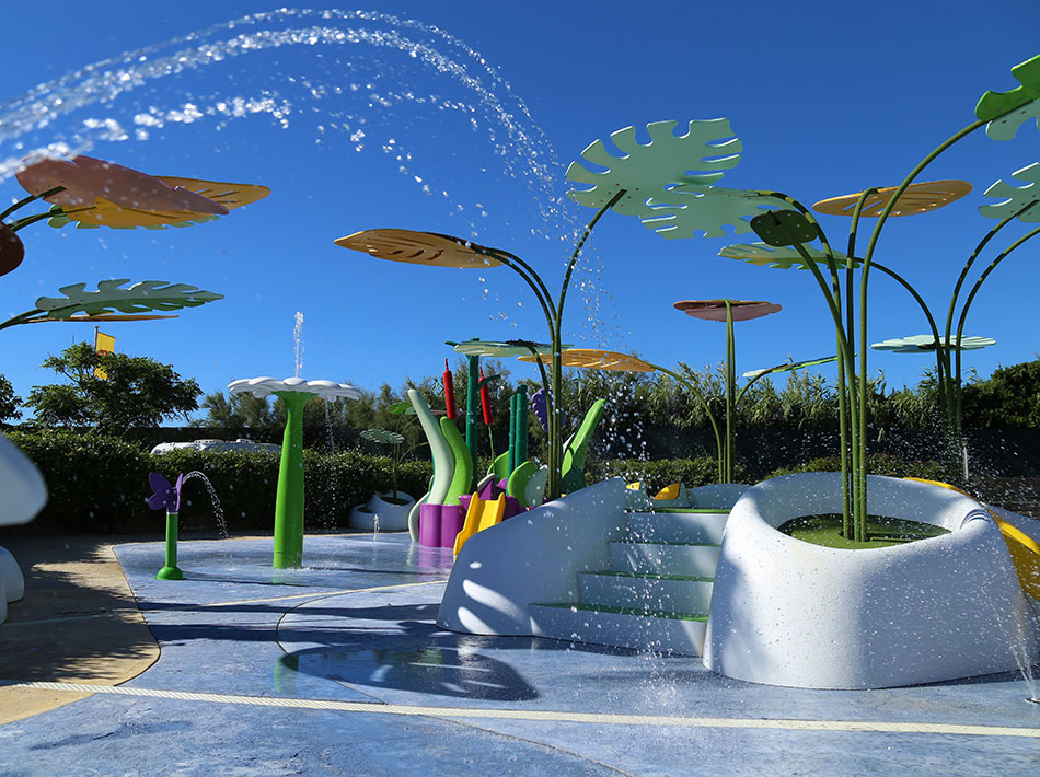 swimming pool with splash pad for the whole family