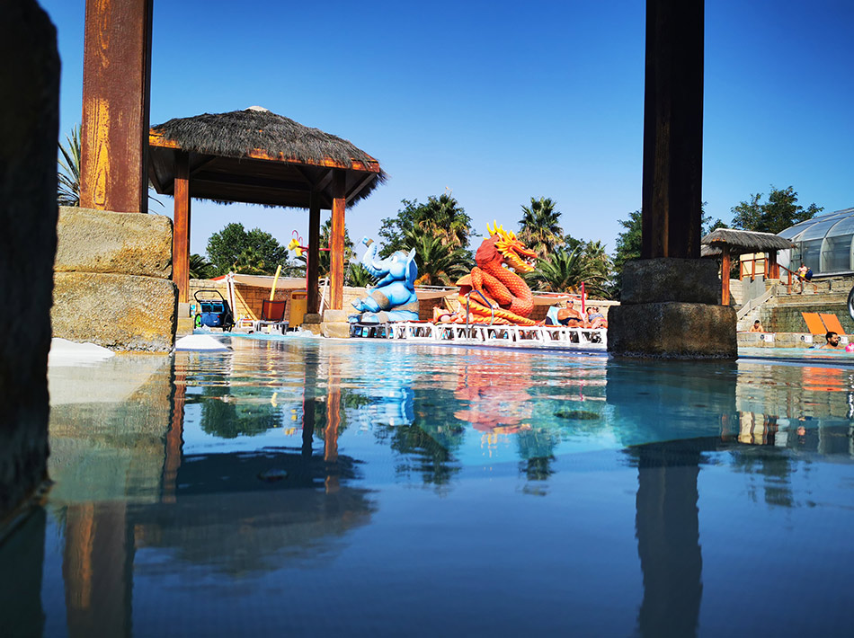 tao swimming pool with slides and jacuzzi at camping farret à vias