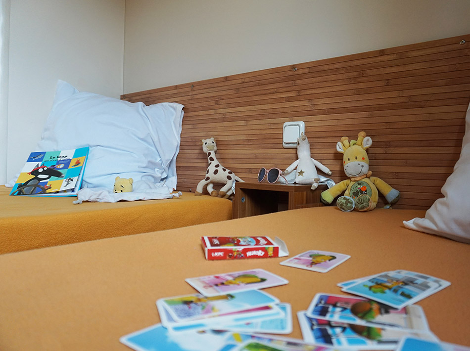 Children bedroom with two single beds, toys, cards, fluffy toys, family holidays