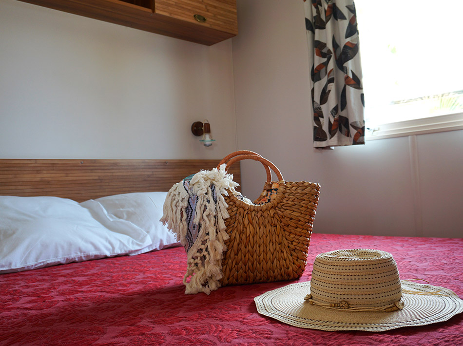 Accommodation with double bed, master bedroom, beach bag, beach towel, straw hat