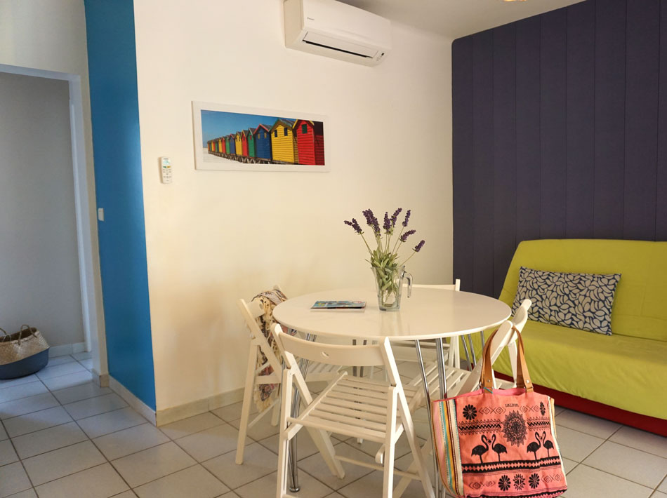 apartment rental large air-conditioned living room with lounge and equipped kitchen